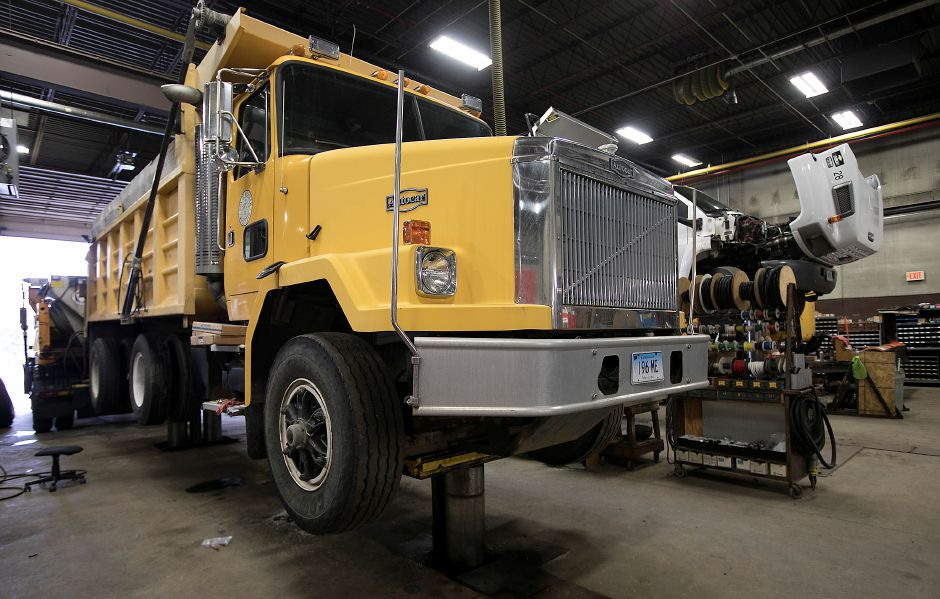 A truck on jacks is serviced in the city garage as crews prepare for a winter storm in Meriden, Friday, Feb. 16, 2018. Dave Zajac, Record-Journal