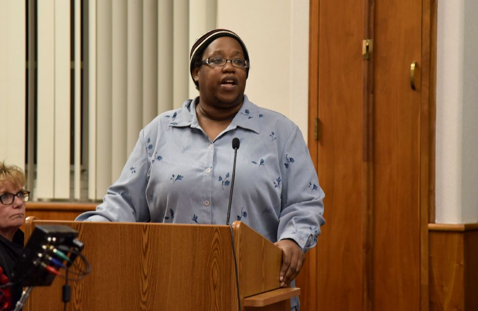 Rev. Ernestine Holloway speaks against the council resolution to terminate city manager Guy Scaife, at a city council meeting on Monday, Dec. 18. The council passed the termination and Fire Chief Ken Morgan was named interim city manager.