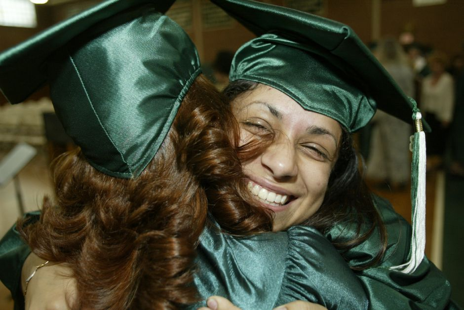 Vanessa Lopez hugs Rebecca Wilson before the beginning of the Maloney High School graduation ceremony Thursday evening, June 19, 2003.