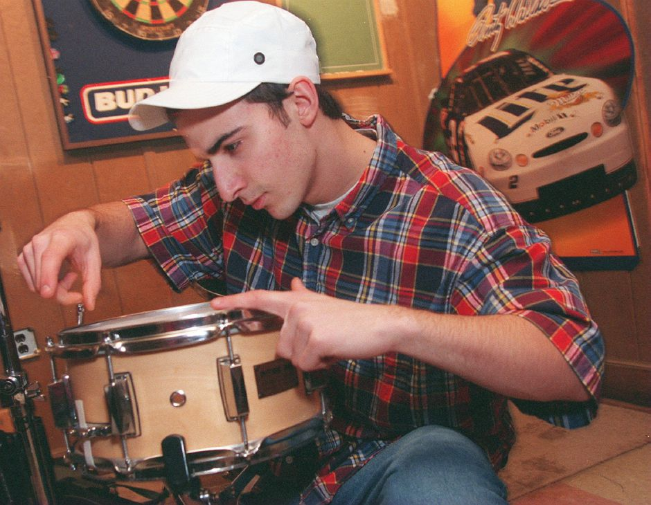 RJ file photo - Teddy Pappas, of Elizabeth , New Jersey, tunes his snare drum while getting ready to carry his drums to the stage area of Hanover House in Meriden, Jan. 1999.