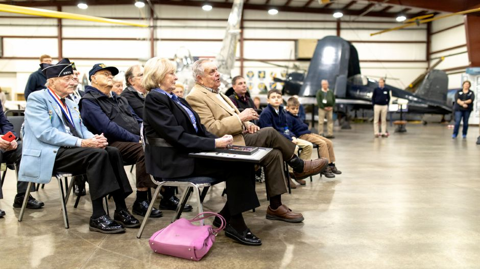 Korean War veteran Robert Rawlings, of Berlin, speaks after receiving replacement service medals at ceremony held at the New England Air Museum in East Granby on Nov. 27, 2018. The medals included the Distinguished Flying Cross and Air Medal. | Devin Leith-Yessian/Berlin Citizen