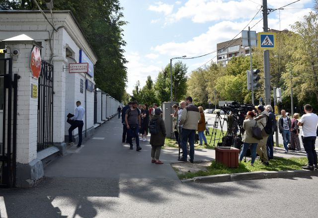 Journalists gather at a hospital where Russian opposition leader Alexei Navalny remained hospitalized, in Moscow, Russia,  July 29, 2019.