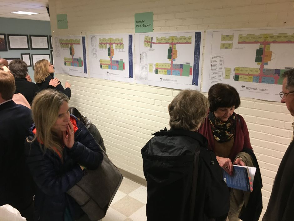 Members of the public review building and grade configuration options being considered by Regional School District 13 at a community information session at Strong School on Wednesday, April 25, 2018. | Lauren Takores, Record-Journal