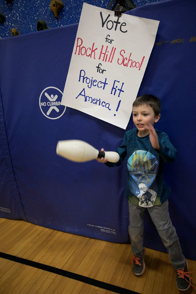 Third-grade student Isaac Santangelo, 8, plays a game of bowling pin dodge ball with his classmates during a physical education class at Rock Hill Elementary School in Wallingford, Thursday, Jan. 11, 2018. Rock Hill Elementary School is competing for a $25,000 grant that would go to purchasing indoor and outdoor fitness equipment. Dave Zajac, Record-Journal
