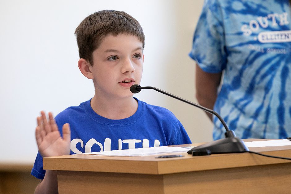 South End Elementary School fifth-grade student Aidan Connor, 10, speaks in favor of keeping his school
