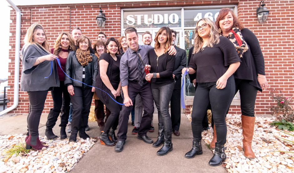 Donna Theriault cuts the ribbon at the new Studio 466 location at 63 East Main Street in Plainville. After years of expansion, Theriault decided to move the salon downtown to a larger site. | Devin Leith-Yessian/Plainville Citizen