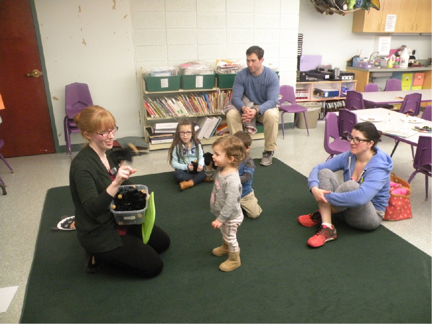 Evelyn Fisher entertains children at the Pajama Story Time program at the North Haven Memorial Library. | Ken Liebeskind, The North Haven Citizen