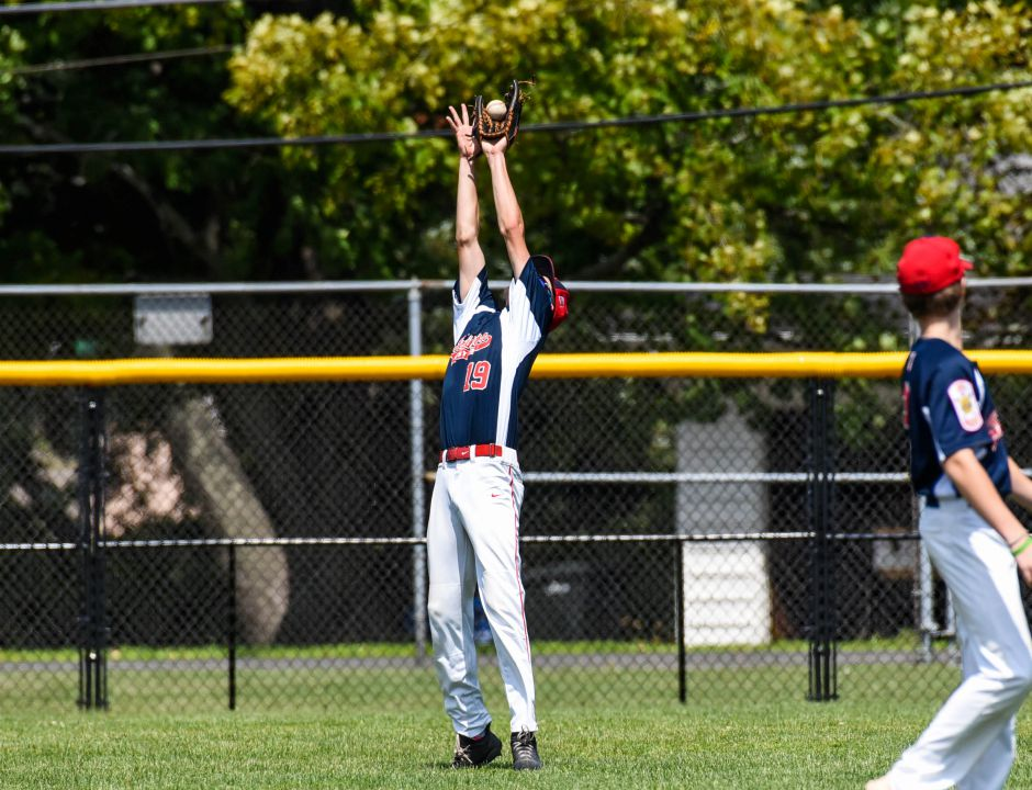 Southingtons Ethan McDonough field a fly ball against Stamford in the American Legion state championship game at Ceppa Field on Saturday