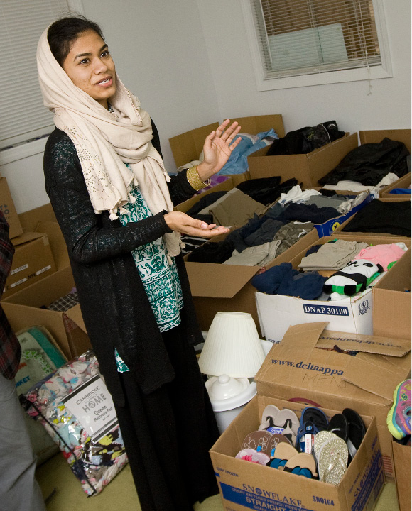 Farah Salam, of Wallingford, talks about clothing donations received for Middle Eastern refugee families at the Islamic Center of Wallingford, Wednesday, December 14, 2016.  | Dave Zajac, Record-Journal