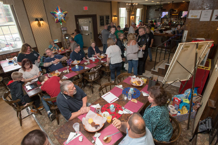 The Elks Lodge filled up quickly for breakfast Sunday during the inaugural Father