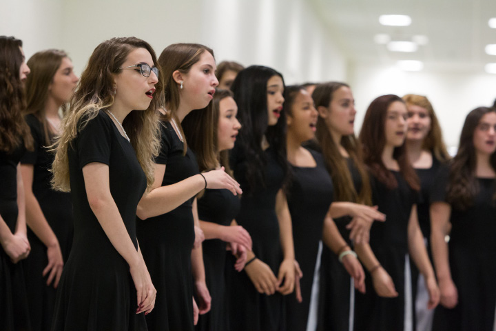 Maloney chamber singers welcome guests Monday during a Ribbon Cutting Ceremony for Maloney High School in Meriden Dec. 12, 2016 | Justin Weekes / For the Record-Journal