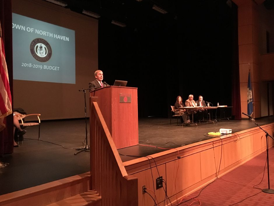 First Selectman Michael Freda presents the proposed town budget at a public hearing at North Haven High School on April 3. | Lauren Takores, The Citizen