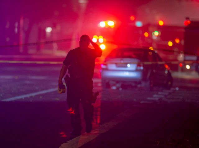 Davis Police closed the area near 5th and C streets in Davis, Calif., after a police officer was shot on Thursday, Jan. 10, 2019. A Davis police officer was shot Thursday night while responding to a traffic accident, and authorities cordoned off parts of downtown while searching for a suspect. (Jose Luis Villegas/The Sacramento Bee via AP)