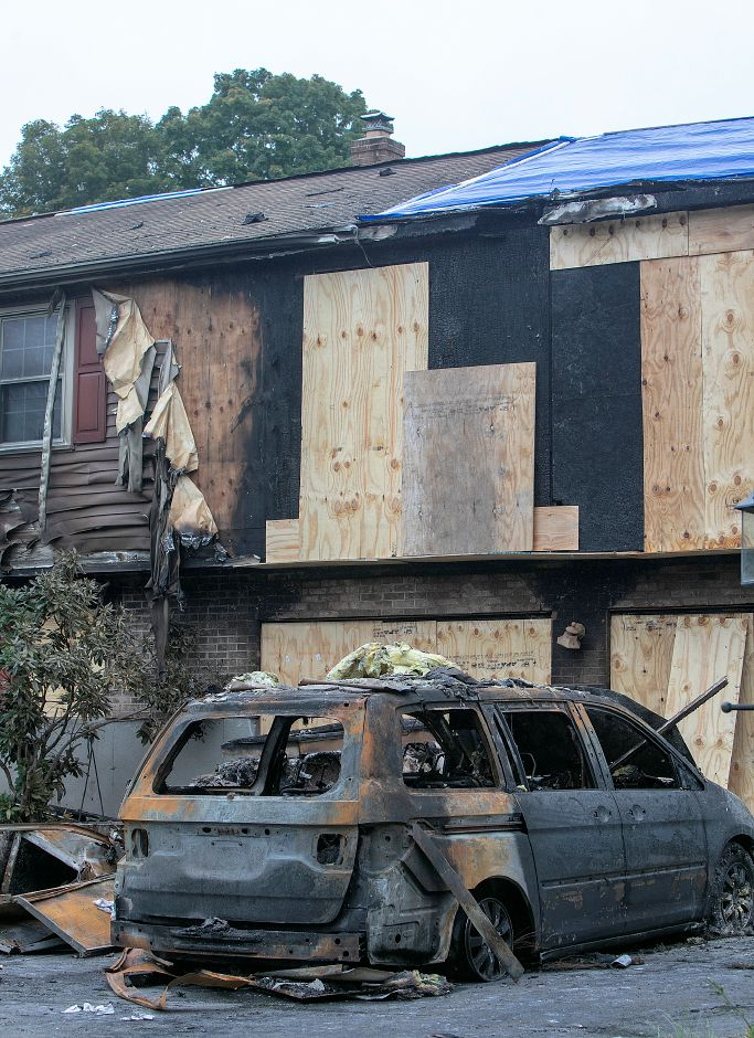 A van destroyed by fire in the driveway of a house at 427 N. Elm St. in Wallingford, Monday, Oct. 8, 2018. Emergency crews responded to the blaze around 3:50 p.m. Sunday, which appears to have started in the garage. Dave Zajac, Record-Journal