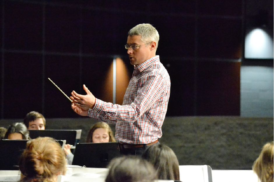 Brian Cyr, Maloney music director, conducts the school band during a rehearsal in 2016.