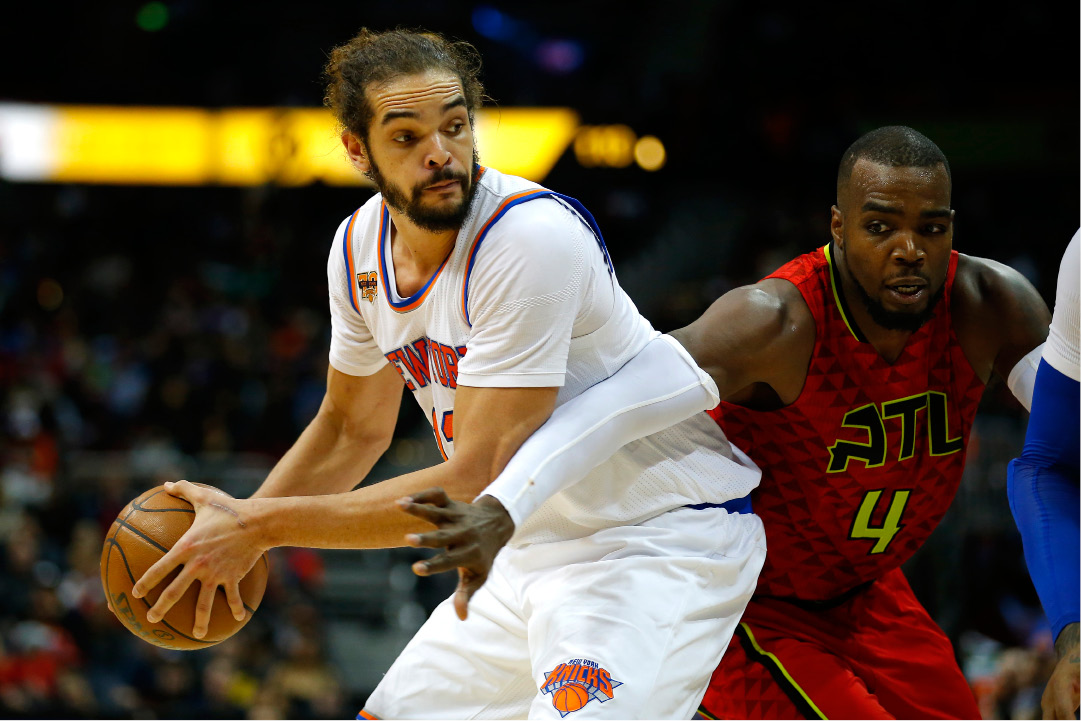FILE - In this Jan. 29, 2017 file photo, New York Knicks center Joakim Noah (13) looks to pass as Atlanta Hawks forward Paul Millsap (4) is defending in the first overtime of an NBA basketball game in Atlanta.  Noah has been suspended 20 games without pay for violating the league