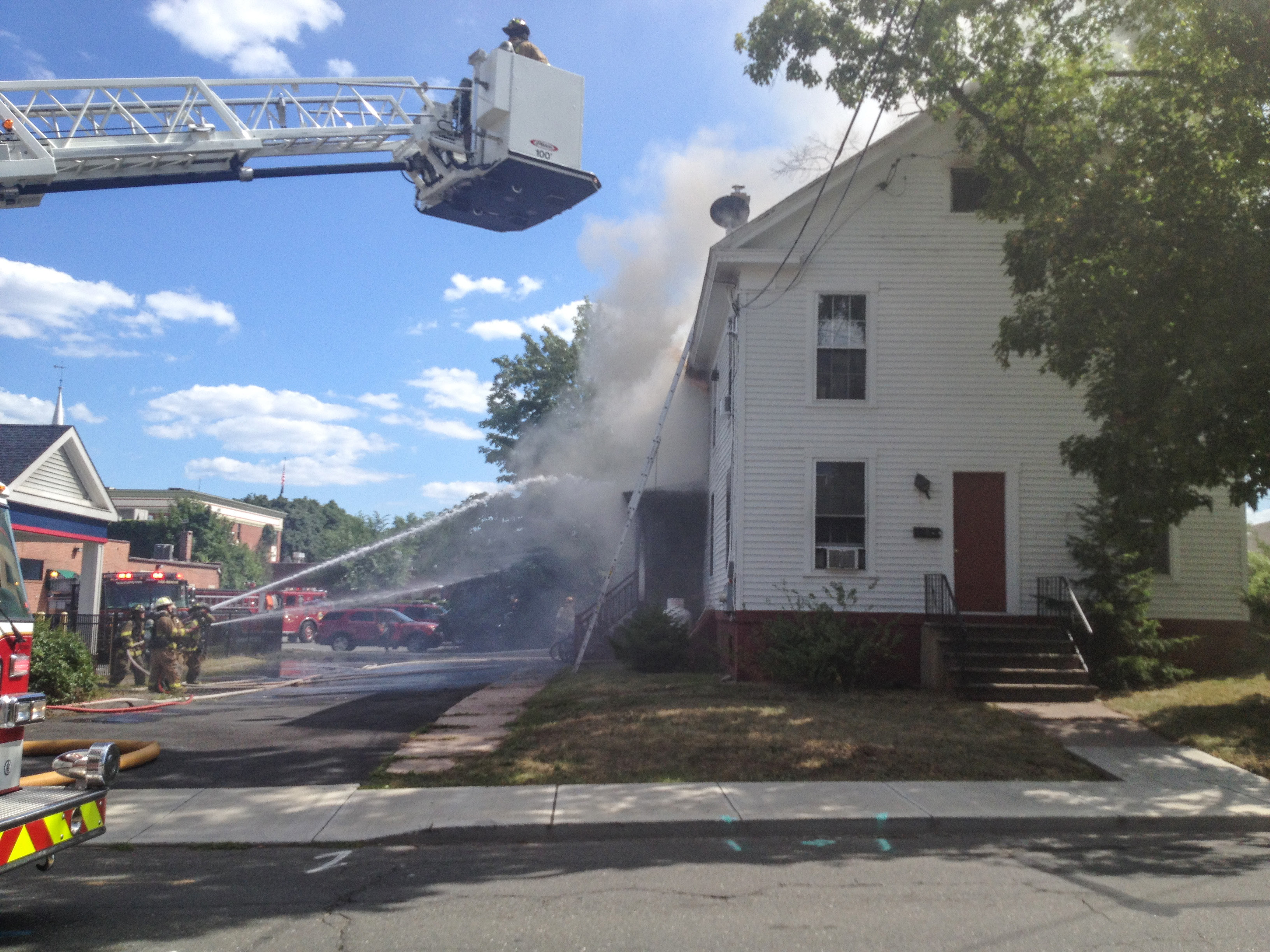 Southington firefighters battle a fire at a home on High Street Wednesday afternoon July 27, 2016. | Dave Zajac, Record-Journal