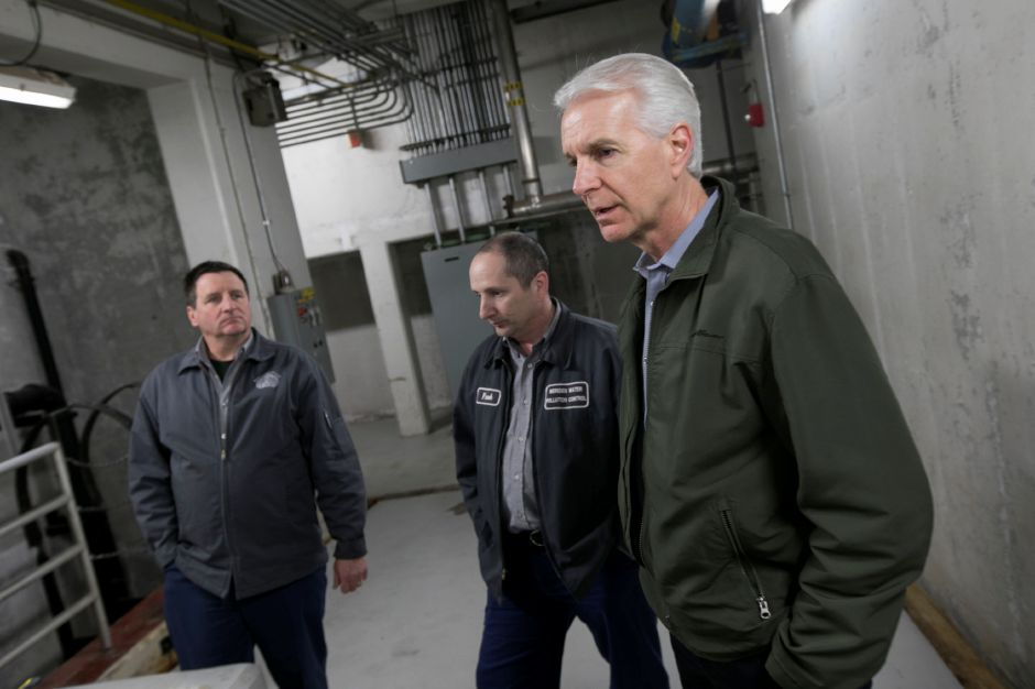 Dennis Waz, director of public utilities, right, speaks next to Frank Russo, manager, center, and Robert Peter, superintendent of operations water and wastewater, left, during a tour of the Water Pollution Control Facility on Evansville Avenue in South Meriden, Thursday, March 30, 2017. In order to meet federal requirements, area towns are investing millions in upgrading water treatment plants to lower the amount of phosphorus being discharged into the Quinnipiac River. | Dave Zajac, Record-Journal
