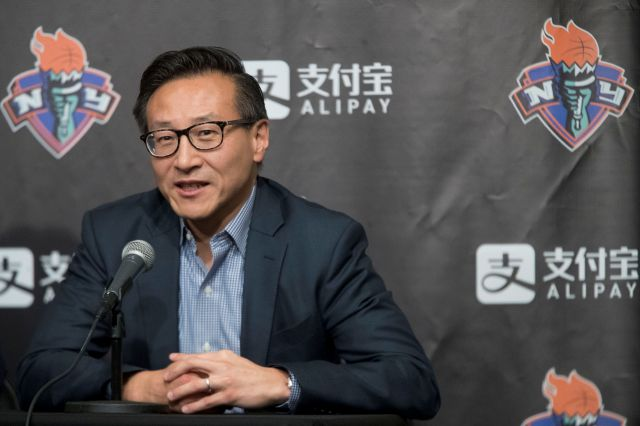 FILE - In this May 9, 2019, file photo, Joe Tsai speaks to reporters during a news conference before a WNBA exhibition basketball game between the New York Liberty and China in New York. The Brooklyn Nets have a new owner and a new CEO. Alibaba co-founder Joe Tsai completed his purchase of the team and Barclays Center on Wednesday,Sept. 18, 2019, then announced that he had hired former Turner Broadcasting President David Levy to oversee both. (AP Photo/Mary Altaffer, File)