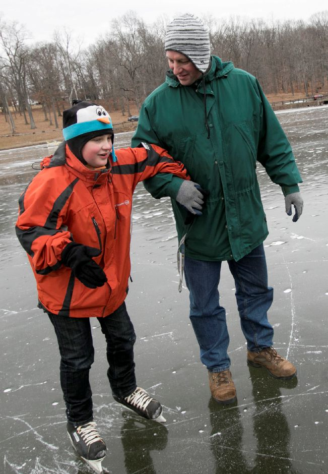 John Fuerstenberg, 10, of Meriden, skates for the first time with assistance from father, Gary, on Mirror Lake at Hubbard Park in Meriden, Monday, Jan. 15, 2018. Hubbard Park is open to public skating after more than 10 years. Dave Zajac, Record-Journal