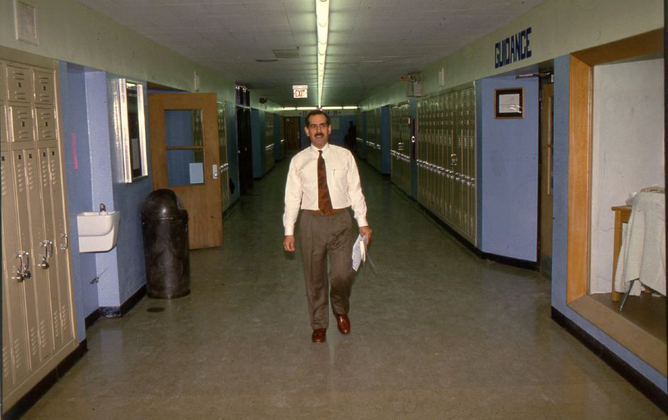 File photo - Platt High School teacher James Ieronimo walks the halls to his classroom Jan. 20, 1994.