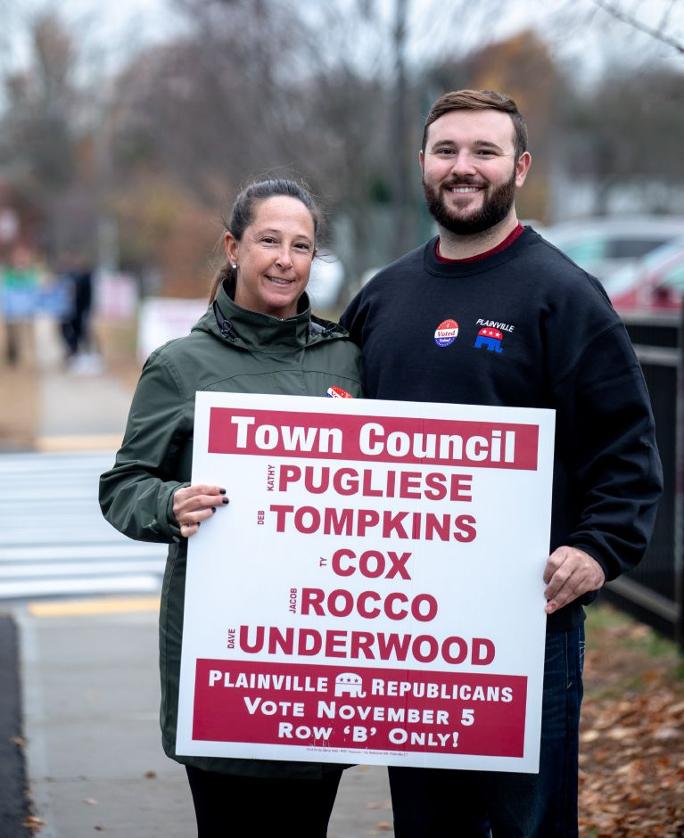 Karen and Ty Cox, from left, hold a campaign sign outside Linden Street School during the Nov. 5, 2019 Plainville municipal election. Ty Cox was one of four Republicans elected to the Town Council, maintaining the party