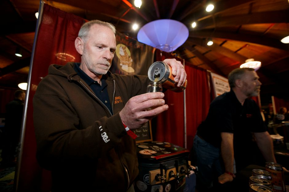 Mike Klucznik of Fat Orange Cat pours a sample of Dream Boat Abbey Belgian Triple Saturday during the inaugural CT Craft Brew Fest in the Dome at The Toyota Oakdale Theater in Wallingford February 17, 2018 | Justin Weekes / Special to the Record-Journal