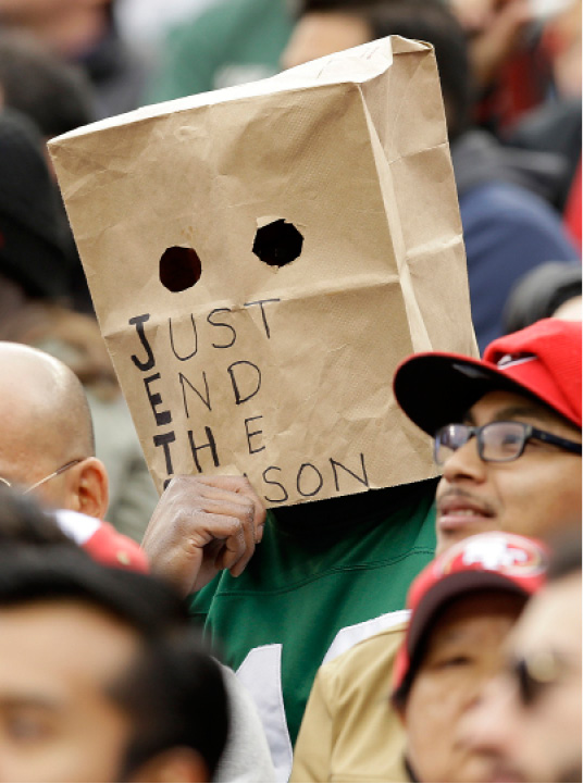 A New York Jets fan wears a bag over their head during the first half of an NFL football game between the San Francisco 49ers and the Jets in Santa Clara, Calif., Sunday, Dec. 11, 2016. (AP Photo/Ben Margot)