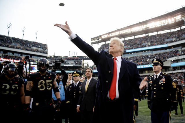 President Donald Trump tosses the coin before the Army-Navy NCAA college football game Saturday, Dec. 8, 2018, in Philadelphia. (AP Photo/Matt Rourke)