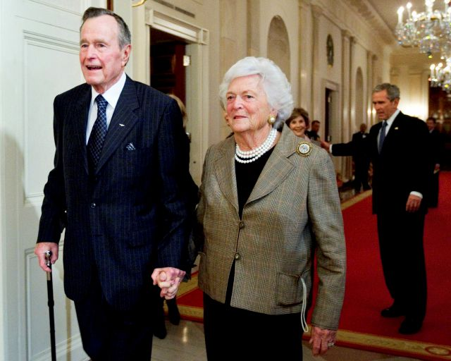 FILE - In this Jan. 7, 2009, file photo, former President George H. W. Bush, left, walks with his wife, former first lady Barbara Bush, followed by their son, President George W. Bush, and his wife first lady Laura Bush, to a reception in honor of the Points of Light Institute, in the East Room at the White House in Washington. Bush died at the age of 94 on Friday, Nov. 30, 2018, about eight months after the death of his wife, Barbara Bush. (AP Photo/Manuel Balce Ceneta, File)