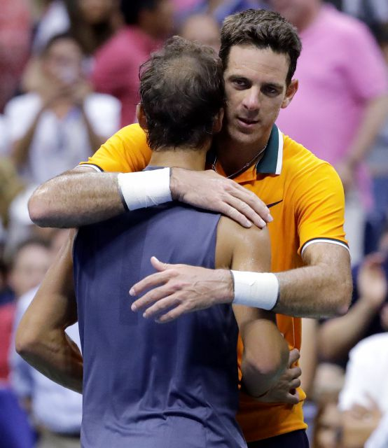 Juan Martin del Potro, of Argentina, hugs Rafael Nadal, of Spain, after Nadal retired from a match during the semifinals of the U.S. Open tennis tournament, Friday, Sept. 7, 2018, in New York. (AP Photo/Seth Wenig)