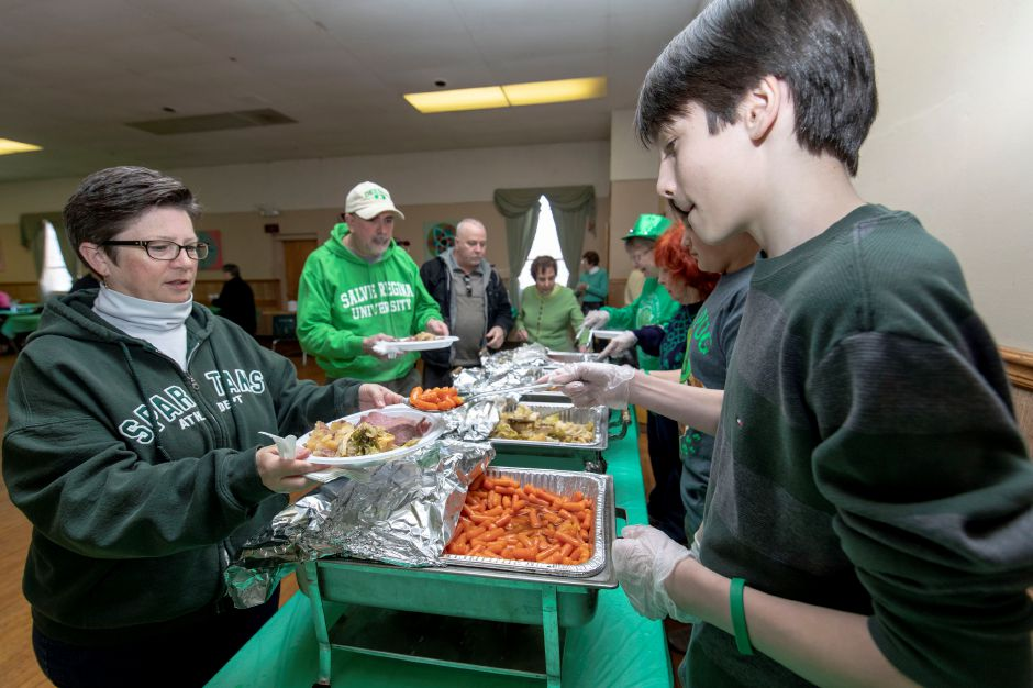 Tyler Cessario, 13, serves food during the Meriden Ancient Order of Hiberians