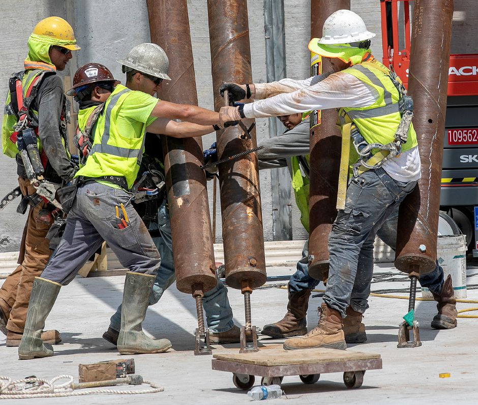 Crews from Preload, a Kentucky-based company, position support pillars into place while installing sections of a new water tank off Mill Street in Southington,Tues., July 16, 2019. Thirty-two ton concrete panels more than 60 feet tall were lifted into place Tuesday to form what will be the town's newest water tank. Dave Zajac, Record-Journal