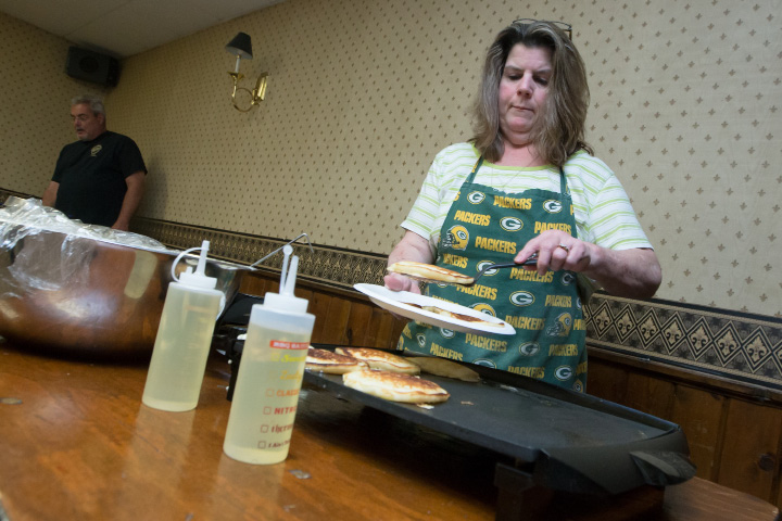 Holly LaFayette serves pancakes to fill an order Sunday during the inaugural Father