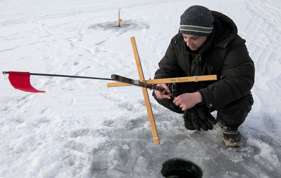 Tomas Zukowski, of New Britain, sets one of several tip-ups while ice-fishing on Black Pond in Middlefield, Tuesday, Jan. 2, 2018. Dave Zajac, Record-Journal