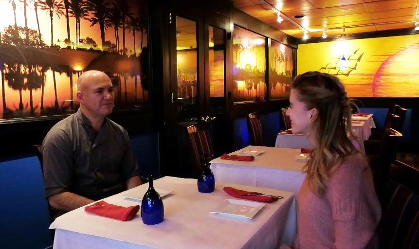 Record-Journal Digital Content Producer Ashley Kus, right, chats with Melvin Lopez, owner and chef at Ola Restaurant.