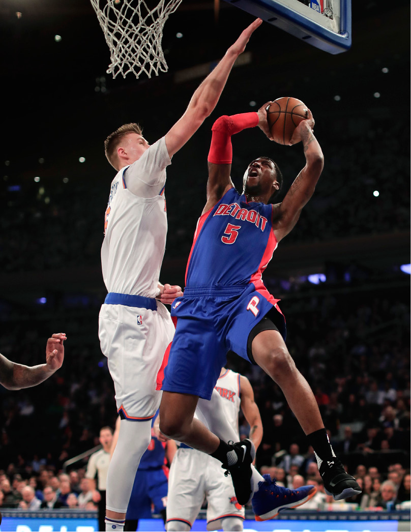 Detroit Pistons guard Kentavious Caldwell-Pope (5) goes up for a shot against New York Knicks forward Kristaps Porzingis (6) during the first quarter of an NBA basketball game, Monday, March 27, 2017, in New York. (AP Photo/Julie Jacobson)