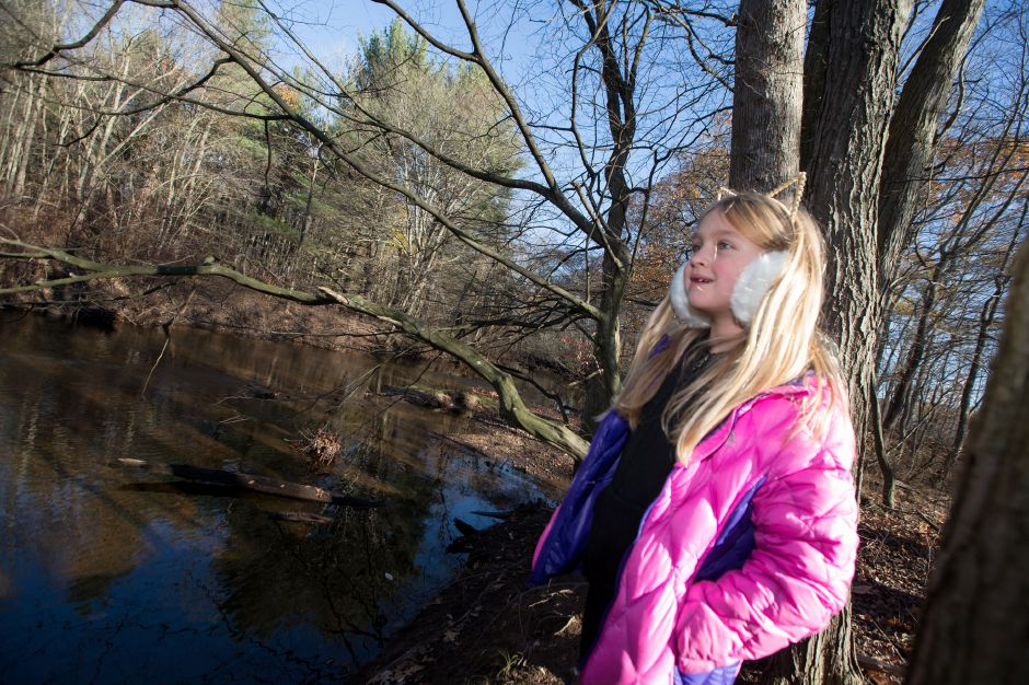 Letty Veleber 8 of Cheshire look out off the bank of the Quinnipiac River Friday during Cheshire Land Trust