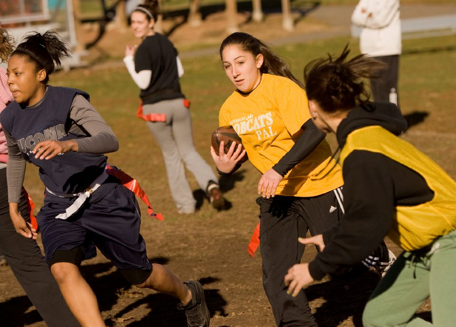 Samantha Roccapriore carries the ball on a run play during Powder Puff practice at Wilcox Tech November 11, 2010. (Dave Zajac/Record-Journal)