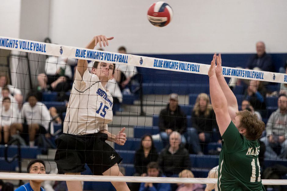 Southington's Alexander Bush gets a spike off for a kill against Maloney  Monday at Southington High School.