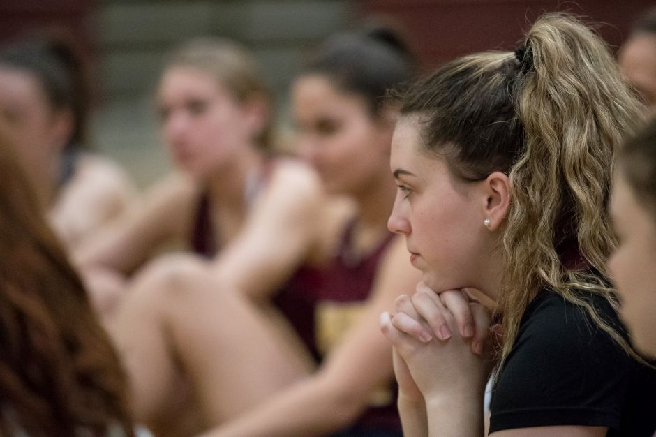 Sheehan's Madison Larkin listens to Cathy Inglese.