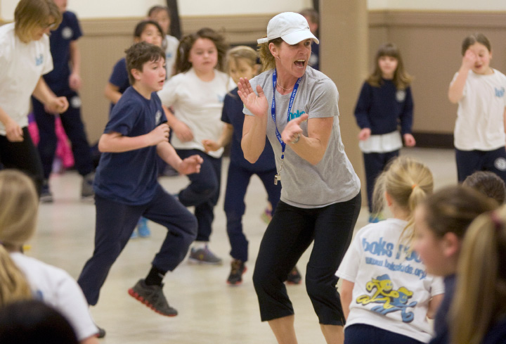 Lisa Suzio, athletic director, gets St. Joseph School students moving one morning in March 2014 as part of the BOKS Challenge — a program created and funded by Reebok that aims to educate children on exercising and eating healthily. |  Dave Zajac, Record-Journal