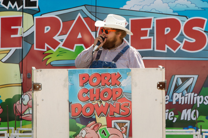 Colton Brooks of Kentucky calls the race in the Show-Me Safari Racing Pigs show Sunday during the 75th Annual North Haven Fair in North Haven September 10, 2017 | Justin Weekes / For the Record-Journal