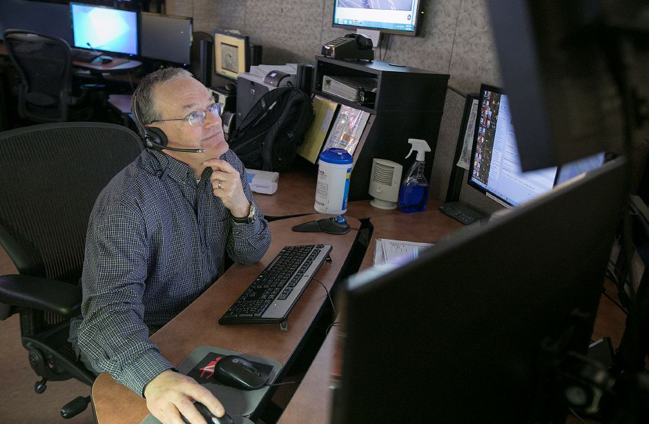 Dispatcher Joseph Silverio, of Plainville, works at his station at the Southington Police Department, Tuesday, April 10, 2018. Dave Zajac, Record-Journal