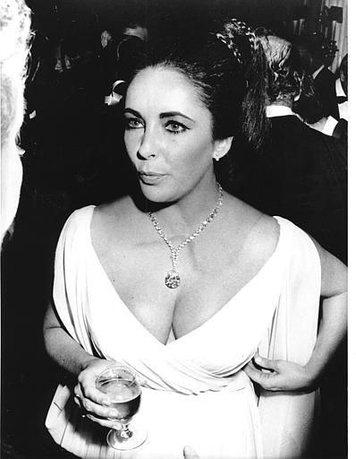 "Elizabeth Taylor attends a charity ball in Monaco, South of France on Nov. 17, 1969. Making its debut is the famous 69.42 carat, pear-shaped diamond that Taylor is wearing as a pendant. It is a present from her husband, Richard Burton. Initially, the diamond was bought by Paris jeweler Cartier at an auction and he named it ""Cartier."" Burton bought it the next day and renamed it ""Taylor-Burton."" (AP Photo/Maestri)"