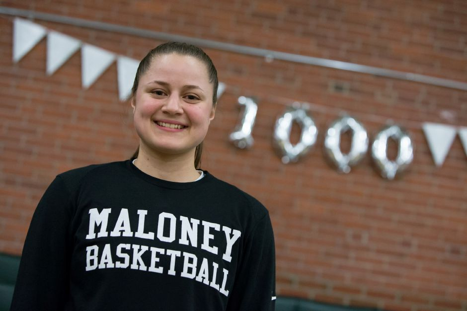Maloney senior Melanie Polanco was officially honored for becoming the school's first girls basketball player to reach 1,000 career points prior to Monday night's home game against Wilcox Tech. Polanco then went out and scored 21 points to lead the Spartans to a 55-29 victory that secured a state tournament berth. | Justin Weekes / Special to the Record-Journal