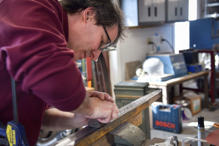 Longtime Middlefield resident Matthew Berry works on a blade Thursday in his backyard shop. Bailey Wright, Record-Journal