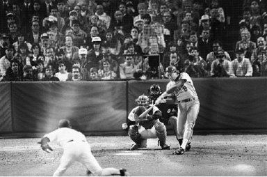 New York Mets Gary Carter (8) hits a two-run homerun off Boston Red Sox pitcher Al Nipper, left, during fourth inning action in the fourth game of the World Series at Fenway Park, Wednesday, Oct. 22, 1986, Boston, Mass. Red Sox catcher her Rich Gedman and home plate umpire Joe Brinkman watch the play. (AP Photo/Mark Lennihan)