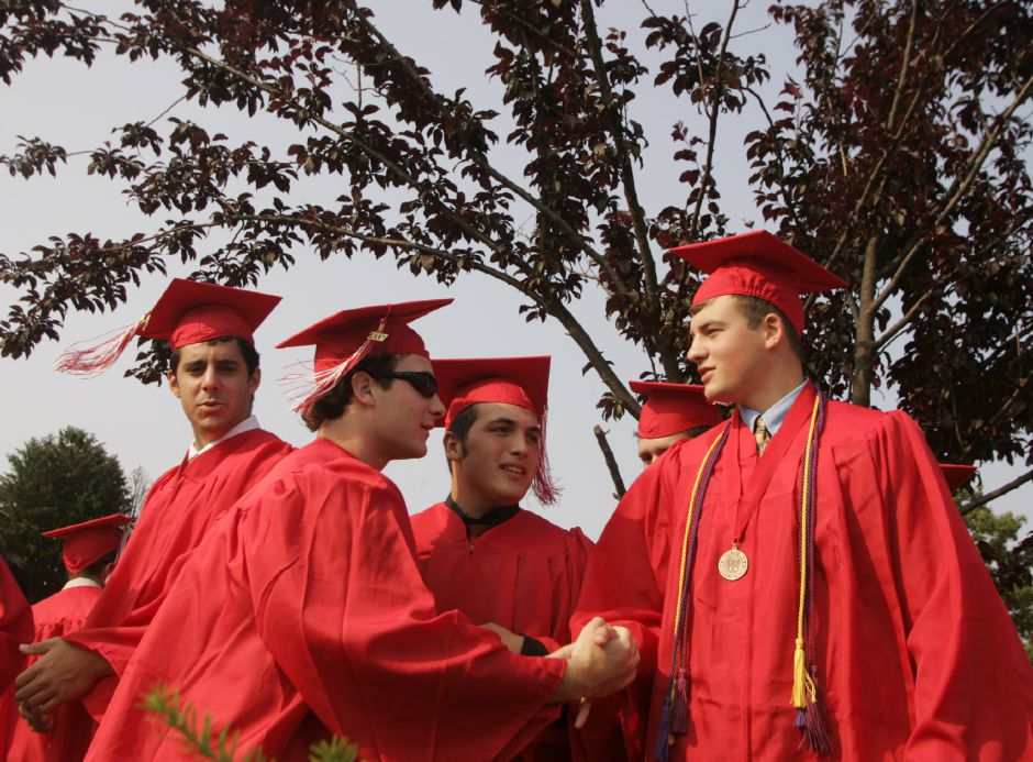 Cheshire graduates Bruce Reynolds, left, and Jake Saslow shake hands prior to commencement ceremonies at Cheshire High School June 20, 2007. (dave zajac photo)