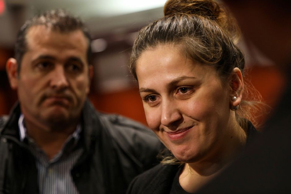 Denada Rondos smiles during an appearance Monday at the Legislative Office Building in Hartford  after announcing she will not be deported while the circuit court hears her appeal. Her husband, Viron Rondos, is at left.Photos by  Dave Zajac, Record-Journal staff